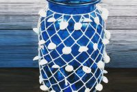 New product..!!  Dollar Store Bastian blue glass vase with net and shells.. Beaut...