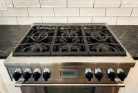 Jet fog, charcoal grout, and subway tiles with a twist on Casa O's backsplash...